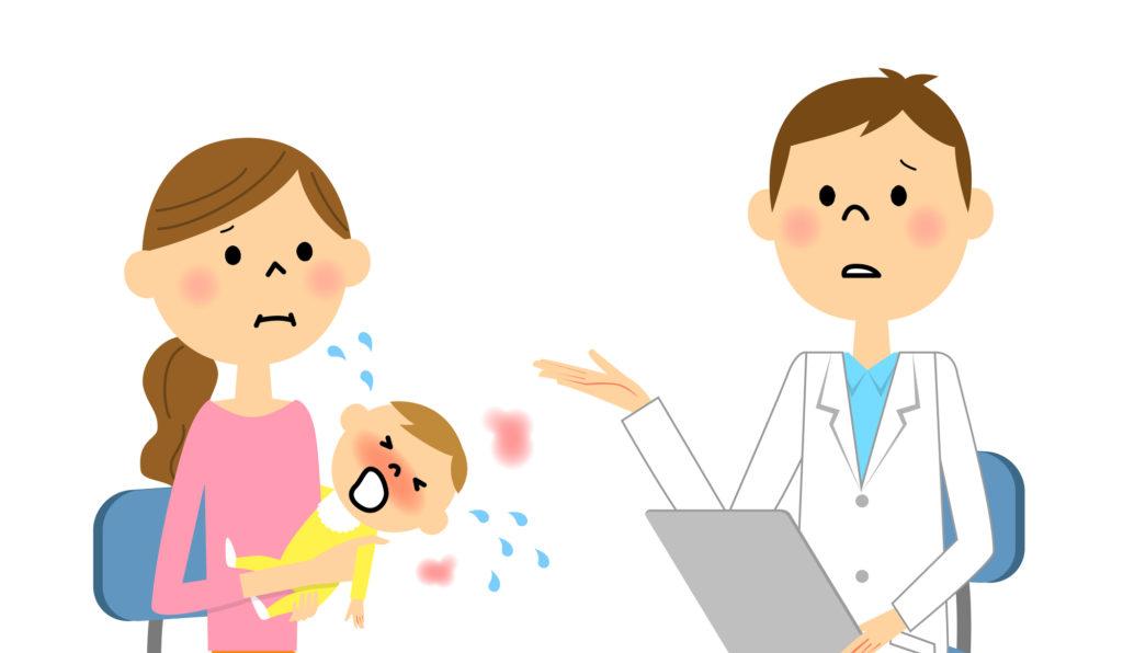 38度以上の熱が出た赤ちゃんを病院に連れて行く母親
